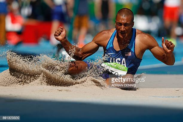 TOPSHOT USA's Ashton Eaton competes in the Men's Decathlon Long Jump during the athletics event at the Rio 2016 Olympic Games at the Olympic Stadium...