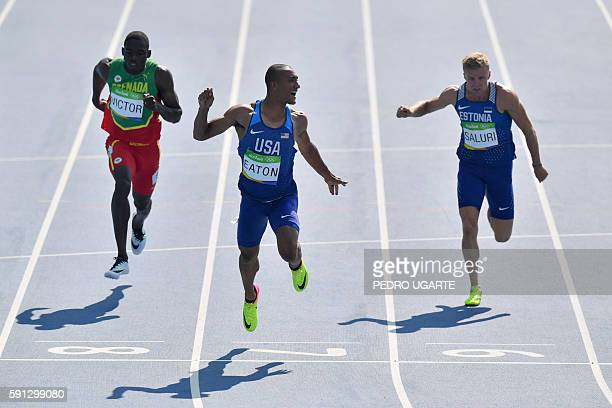 TOPSHOT USA's Ashton Eaton reacts as he crosses the finish line in a Men's Decathlon 100m heat during the athletics event at the Rio 2016 Olympic...