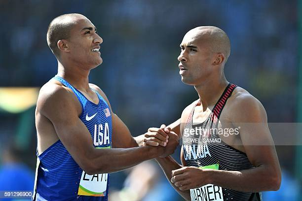 USA's Ashton Eaton shakes hands with Canada's Damian Warner after they competed in a Men's Decathlon 100m heat during the athletics event at the Rio...