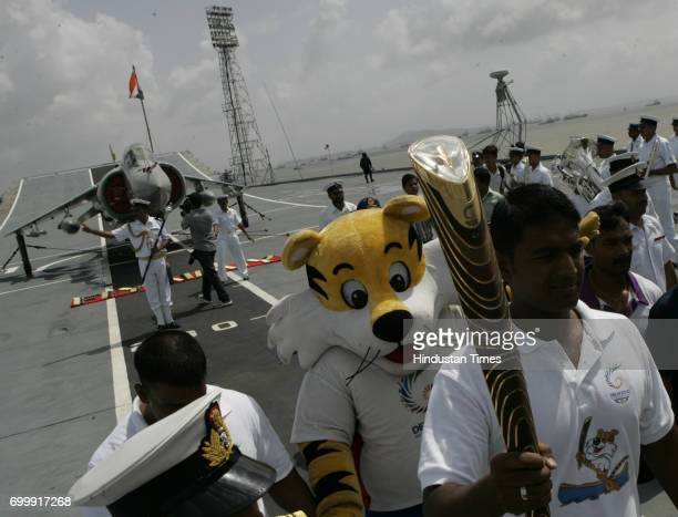 CWG's Baton along with 'Shera' on R22 INS Virat Deck's at Navy Docks in Mumbai on Friday