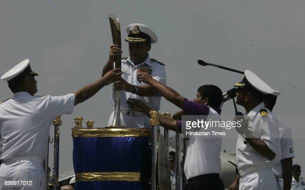 CWG's Baton hand over to Cdr of INS Virat at Navy Docks in Mumbai