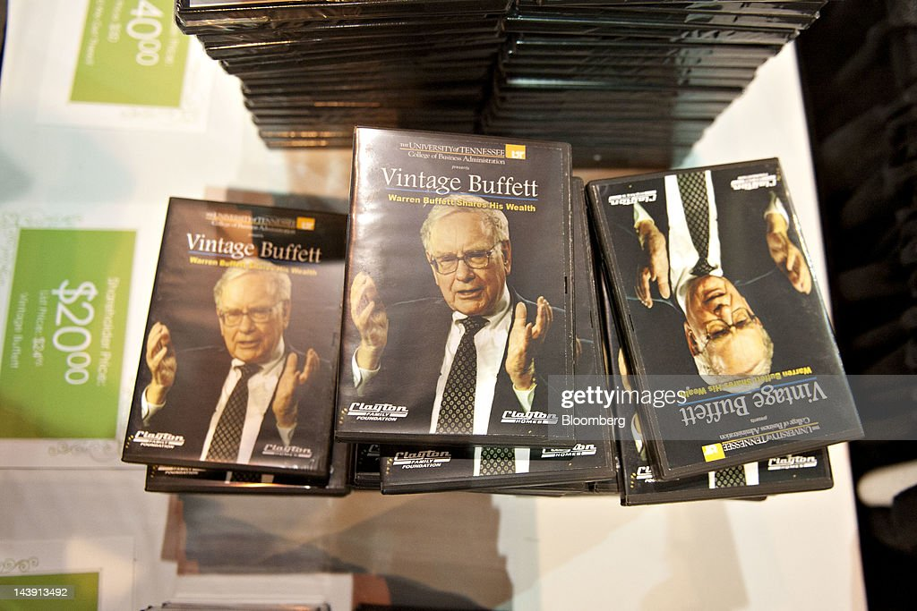 DVD's bearing an image of Warren Buffett chairman of Berkshire Hathaway Inc sit on display during the Berkshire Hathaway annual shareholders meeting...