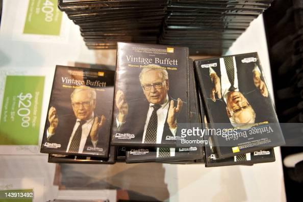 DVD's bearing an image of Warren Buffett chairman of Berkshire Hathaway Inc sit on display during the Berkshire Hathaway annual shareholders meeting...