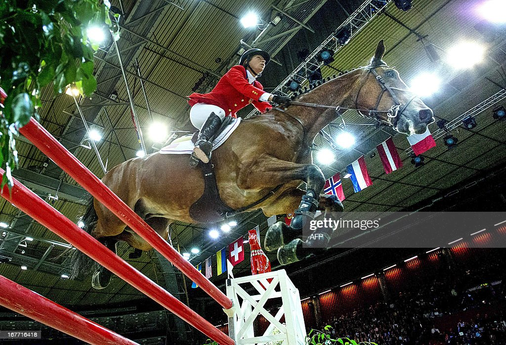 USA's Beezie Madden rides her horse Simon to win the Rolex FEI World Cup Jumping final on April 28, 2013 during the Gothenburg Horse Show in Scandinavium.