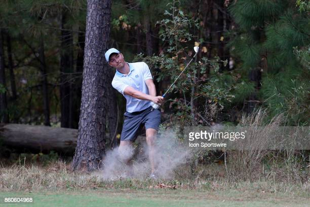 UNC's Ben Griffin hits out of the trees on the 4th hole The second round of the Tar Heel Intercollegiate Men's Golf Tournament was held on October 7...
