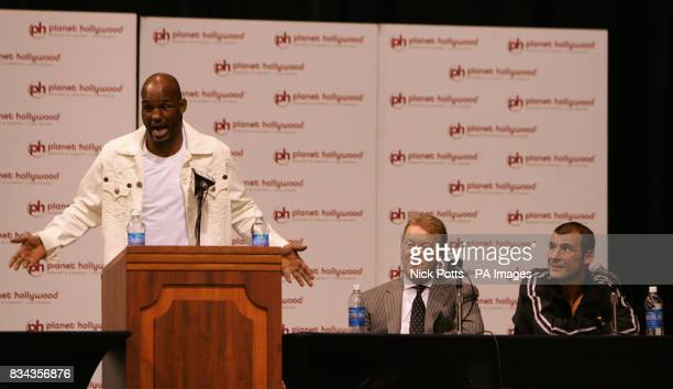USA's Bernard Hopkins complains of judges verdict at post fight press conference as Wales' Joe Calzaghe sits with Promoter Frank Warren at Thomas...