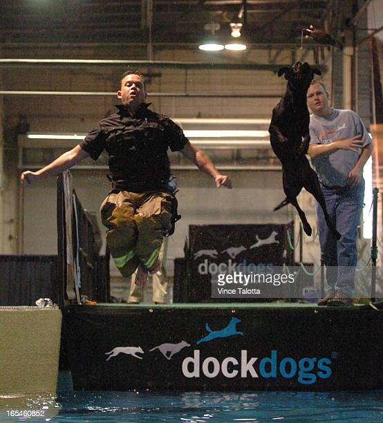 MAN's BEST FRIEND IN JUMPOFF NATIONAL HOME SHOW PITS MAN AGAINST BEAST AT DOCK DOGS COMPETITION FOR CANCER York Region firefighter Shaun Mitchell...