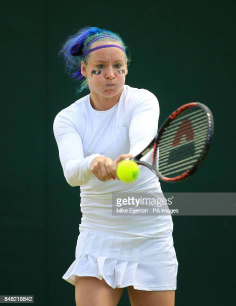 USA's Bethanie MattekSands with her hair in the Wimbledon colours during her doubles match with India's Sania Mirza during day five of the 2012...
