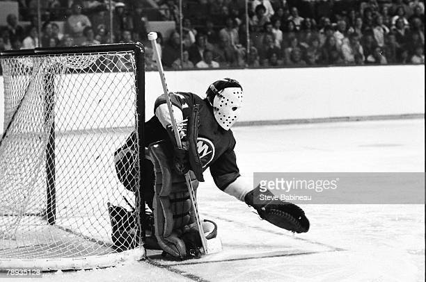 BOSTON MA 1970's Billy Smith of the New York Islanders makes glove save plays against the Boston Bruins