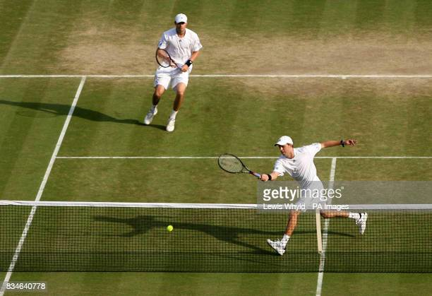 USA's Bob and Mike Bryan in action against Spain's Santiago Ventura and Marcel GranollersPujol in their doubles match during the Wimbledon...