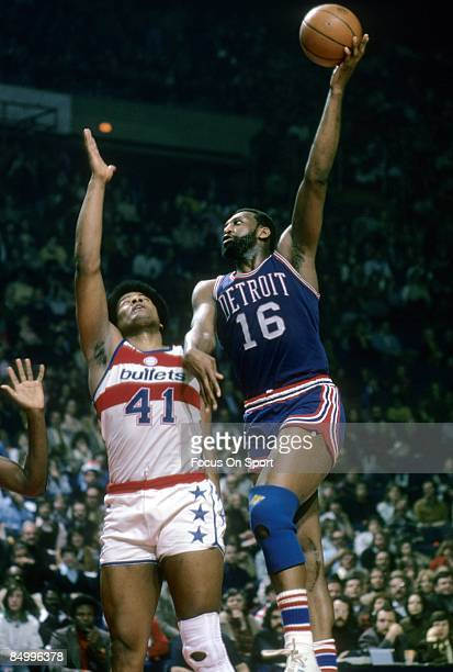 BALTIMORE MD CIRCA 1970's Bob Lanier of the Detroit Pistons in action shooting over Wes Unseld of the Washington Bullets during a mid circa 1970's...
