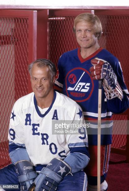 CIRCA 1970's Bobby Hull of the Winnipeg Jets standing and Gordy Howe of the Houston Aeros sitting pose together for this photo before a WHA Hockey...