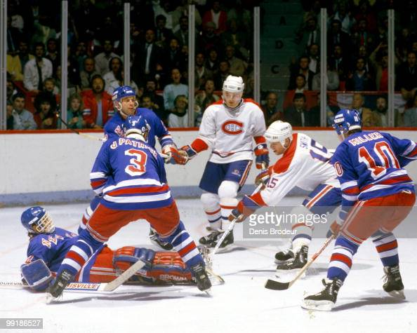 MONTREAL 1980's Bobby Smith of the Montreal Canadiens skates against James Patrick and Kelly Miller of the New yrk Rangers during the 1980's at the...