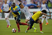 USA's Bobby Wood is marked by Ecuador's Walter Ayovi and Arturo Mina during their Copa America Centenario football tournament quarterfinal match in...