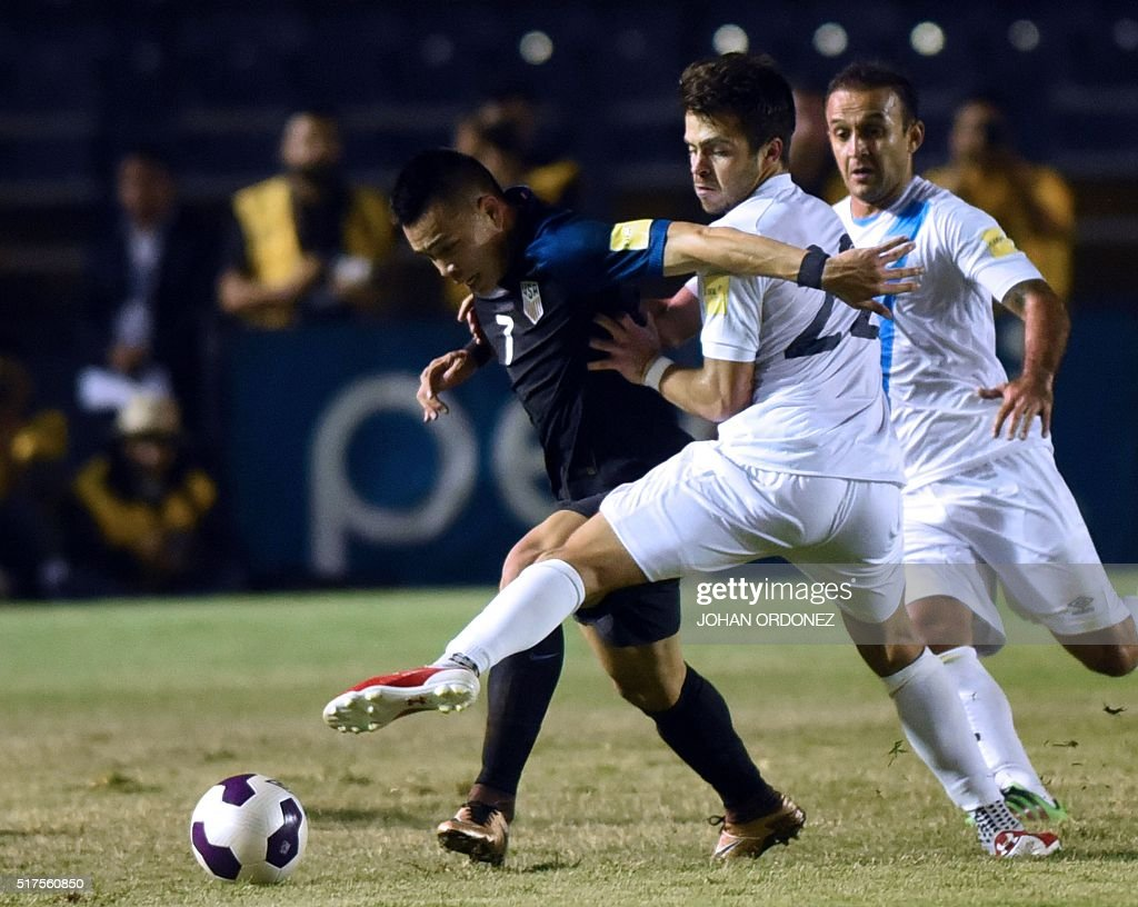 USA's Bobby Wood is marked by Guatamala's Rodrigo Saravia during their Russia 2018 FIFA World Cup Concacaf Qualifiers' football match in Guatemala...