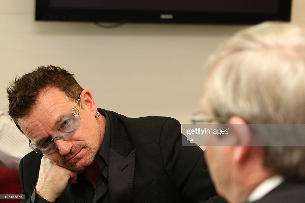 U2's Bono listens in as Australian Foreign Minister Kevin Rudd talks about aid for HIV sufferers at the Sydney Opera House on November 28 2010 in...