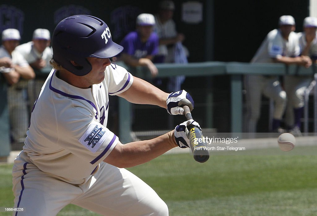 TCU's Boomer White bunts against Oklahoma State on Sunday, May 14, 2013, in Fort Worth, Texas.