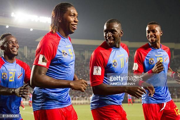 DRC's Botuli Padou Bompunga Dieumerci Mbokani Bolasie Yala and Jonathan Bolingi celebrate during the FIFA World Cup qualifier between the Democratic...