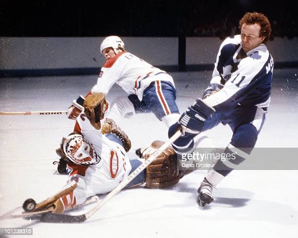 MONTREAL 1970's Brian Engblom and Ken Dryden of the Montreal Canadiens defend against the Toronto Maple Leafs in the 1970's at the Montreal Forum in...