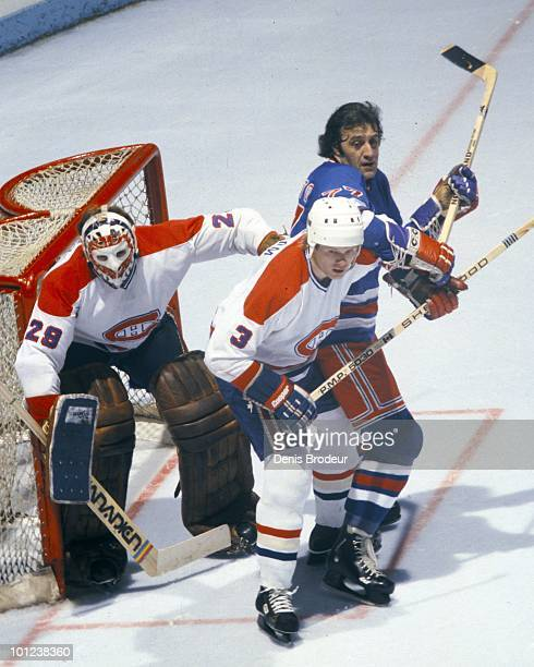 MONTREAL 1970's Brian Engblom of the Montreal Canadiens helps to protect the net with goalie Ken Dryden against Phil Esposito of the New York Rangers...