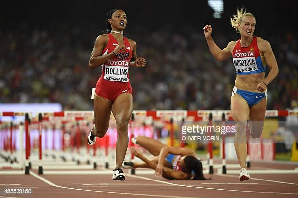 USA's Brianna Rollins and Russia's Nina Morozova run through the finish line as Croatia's Andrea Ivancevic lies on the floor after falling in a...