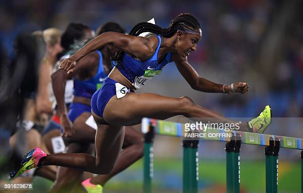 TOPSHOT USA's Brianna Rollins competes in the Women's 100m Hurdles Final during the athletics event at the Rio 2016 Olympic Games at the Olympic...