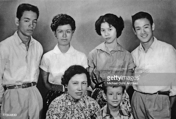 LATE 1950's Bruce Lee along with his mother and siblings pose for a family snapshot circa the late 1950's in Kowloon Hong Kong