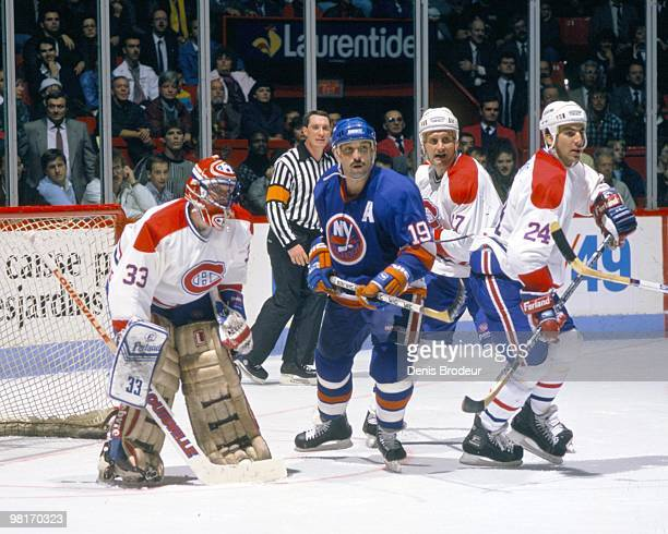 MONTREAL 1980's Bryan Trottier of the New York Islanders skates against goaltender Patrick Roy Craig Ludwig and Chris Chelios of the Montreal...