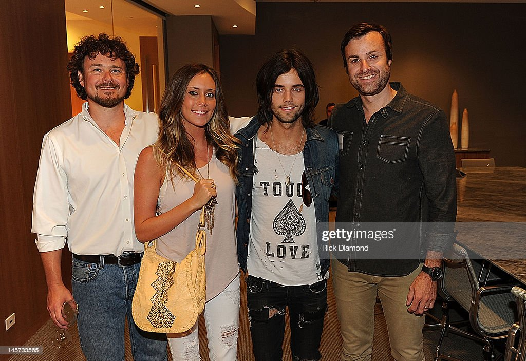 CAA's Buster Phillips, Maggie Eckford, Hot Chelle Rae's Ian Keaggy, and CAA's Matthew Morgan celebrate the new CAA Nashville offices at the 20th Annual CAA BBQ on June 4, 2012 in Nashville, Tennessee.