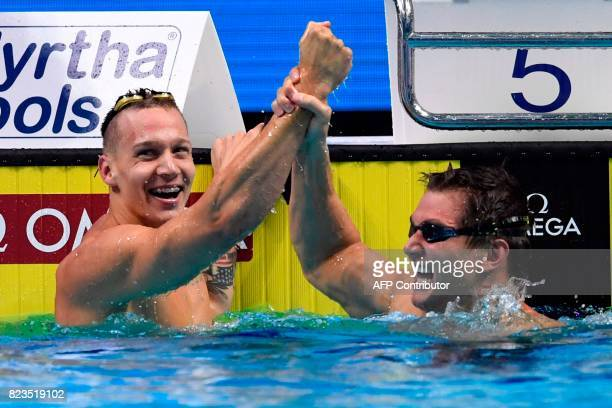 USA's Caeleb Remel Dressel celebrates with USA's Nathan Adrian after winning the men's 100m freestyle final during the swimming competition at the...