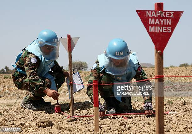 UNIFIL's Cambodian mine experts demonstrate their work on April 23 2014 in the UNcontrolled buffer zone where demining operations are being conducted...