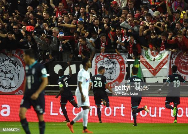 LOSC's Cameronian midfielder Ibrahim Amadou celebrates with supporters after LOSC's French defender Fode BalloToure scored a goal during the French...