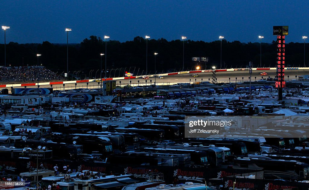 RV's, Campers and haulers are seen parked on the infield as cars race down the backstretch during the NASCAR Sprint Cup Series Bojangles' Southern 500 at Darlington Raceway on May 11, 2013 in Darlington, South Carolina.
