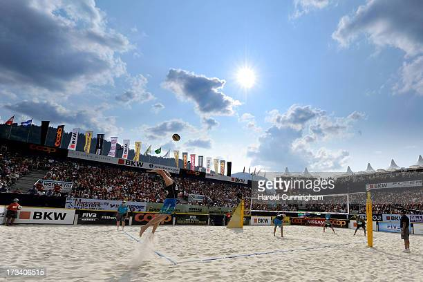 USA's Casey Patterson serves during the GibbPatterson v PedroBruno semifinals match as part of the FIVB Gstaad Grand Slam fifth day on July 13 2013...