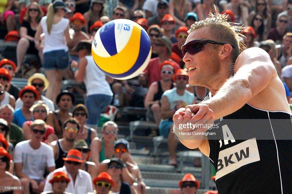 USA's Casey Patterson sets during the Gibb-Patterson v Pedro-Bruno semi-finals match as part of the FIVB Gstaad Grand Slam fifth day on July 13, 2013 in Gstaad, Switzerland.