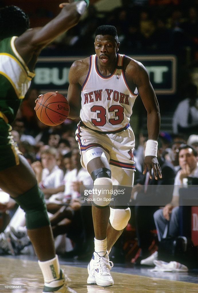MANHATTAN, NY - CIRCA 1990's: Center Patrick Ewing #33 of the New York Knicks in action dribbles the ball up court against the Seattle Super Sonics circa early 1990's during an NBA basketball game at Madison Square Garden in Manhattan, New York. Ewing played for the Knicks from 1985-00.
