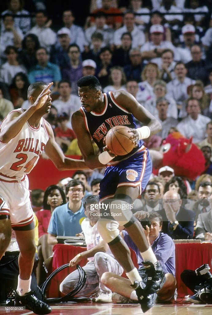 CHICAGO IL CIRCA 1990's Center Patrick Ewing of the New York Knicks in action is guarded by center Bill Cartwright of the Chicago Bulls circa early...