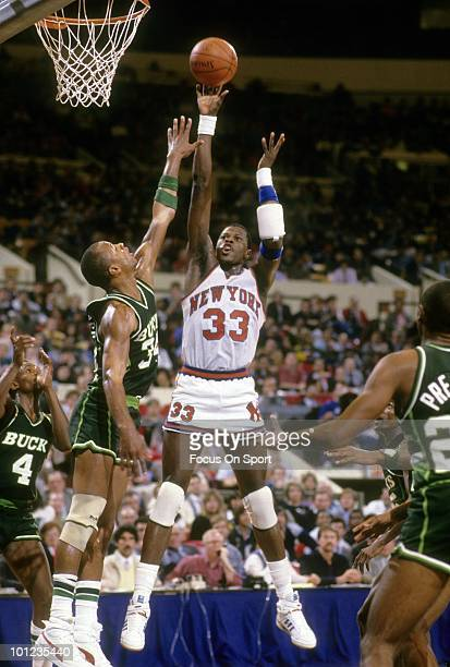 MANHATTAN NY CIRCA 1980's Center Patrick Ewing of the New York Knicks in action shoots over Terry Cummings of the Milwaukee Bucks circa late 1980's...