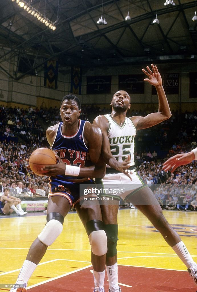 MILWAUKEE, WI - CIRCA 1980's: Center Patrick Ewing #33 of the New York Knicks in action underneath the basket is guarded by Paul Pressey #25 of the Milwaukee Bucks circa late 1980's during an NBA basketball game at the Milwaukee Arena in Milwaukee, Wisconsin. Ewing played for the Knicks from 1985-00.