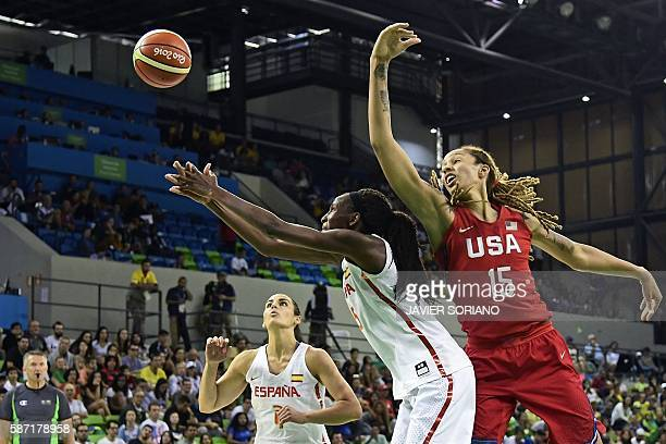 TOPSHOT USA's centre Brittney Griner and Spain's power forward Astou Ndour go for the ball during a Women's round Group B basketball match between...