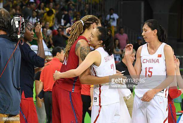 USA's centre Brittney Griner embraces China's small forward Shao Ting after a Women's round Group B basketball match between China and USA at the...