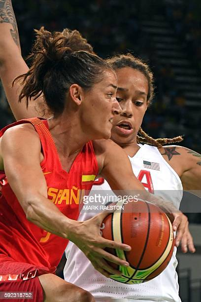 USA's centre Brittney Griner holds off Spain's point guard Laia Palau during a Women's Gold medal basketball match between USA and Spain at the...