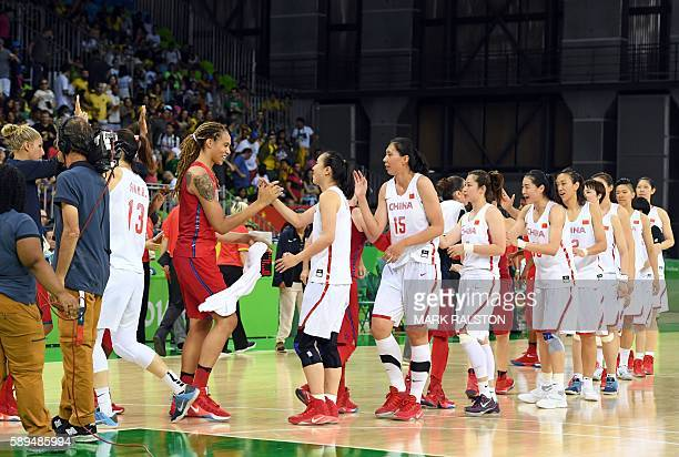 USA's centre Brittney Griner tap hands with China's small forward Shao Ting after a Women's round Group B basketball match between China and USA at...