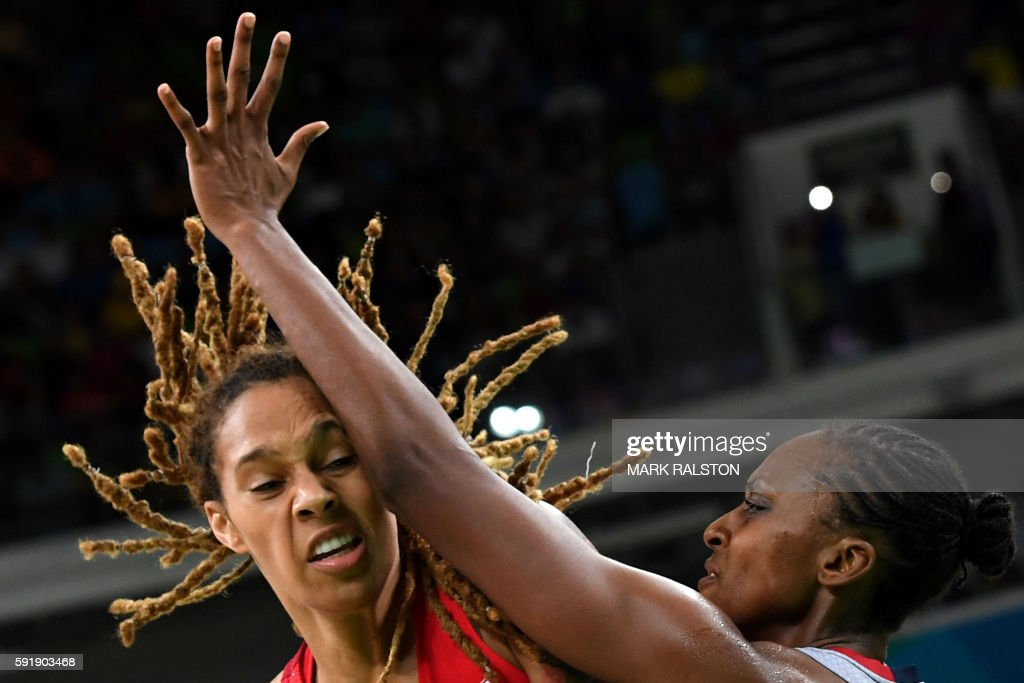 TOPSHOT USA's centre Brittney Griner vies with France's centre Sandrine Gruda during a Women's semifinal basketball match between France and USA at...