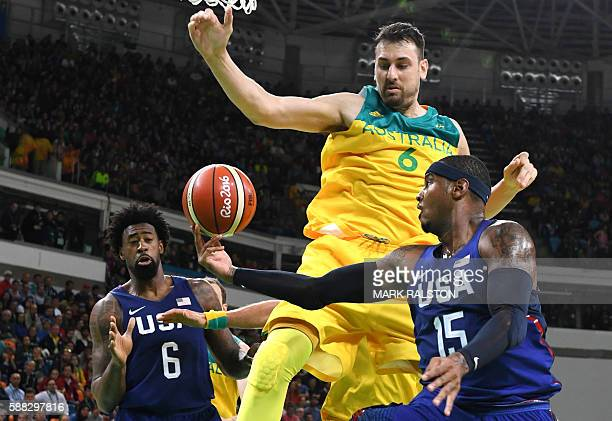 TOPSHOT USA's centre DeAndre Jordan and USA's forward Carmelo Anthony reach for the ball with Australia's centre Andrew Bogut during a Men's round...