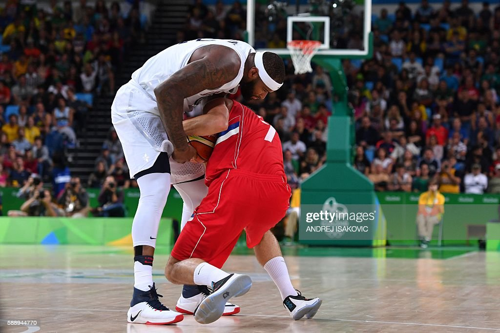 TOPSHOT USA's centre DeMarcus Cousins and Serbia's shooting guard Bogdan Bogdanovic go for the ball during a Men's round Group A basketball match...