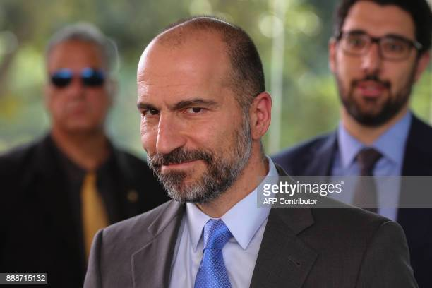 UBER's CEO Dara Khosrowshahi smiles after meeting with Brazilian Finance Minister Henrique Meirelles in Brasilia Brazil on October 31 2017 PHOTO /...