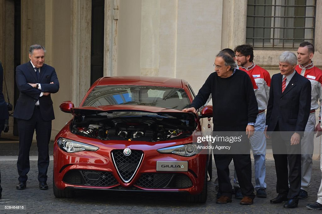 FCA's CEO Sergio Marchionne and engineers of the 'Giulia' inspect the car during Italian automotive company Fiat-Chrysler Group (FCA) introduces Alfa Romeo's new brand sports car 'Giulia' with a ceremony at the yard of Chigi palace in Rome, Italy on May 5, 2016.