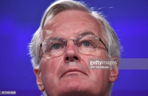 EU's chief Brexit negotiator Michel Barnier addresses the media with his British counterpart following a sixth round of Brexit talks at the European...