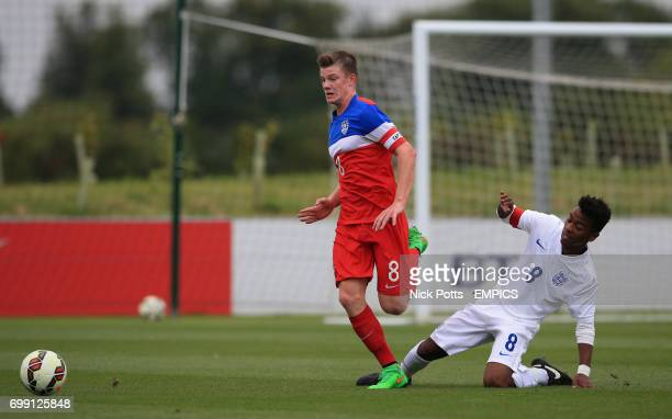 USA U16's Chris Durkin wins the ball off Angel Gomes